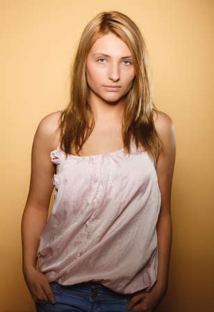 tratment: Skin care. Attractive blonde woman with no makeup, fresh face with natural make up, brown background