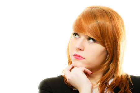 looking upwards: Portrait of beauty redhair thoughtful business woman or student girl looking upwards, isolated on white background Stock Photo