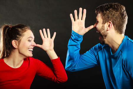 mocking: Happy couple mocking having fun playing the fool. Joyful man and woman have nice time. Good relationship.