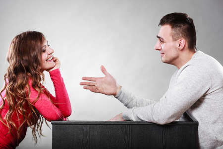 reaching out: Man trying to reconcile with woman. Couple making up after quarrel. Husband reaching out to wife.