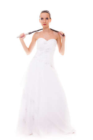 dominant woman: Wedding day. Full length young attractive bride in white dress with black leather flogging whip isolated on white background