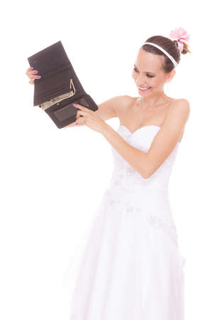 expenditure: Bride with one dollar and wallet. Young girl holding purse and money cash. Wedding expenses costs, expenditure. Marriage and finance concept. Woman in white wedding dress isolated on white background. Stock Photo
