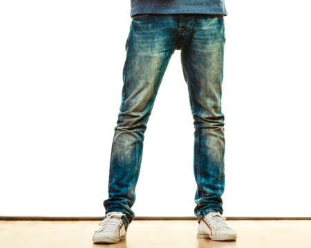 denim trousers: Fashion and teenager concept. Male legs in denim trousers casual style isolated on white background