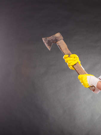 axe girl: woman holding axe chopper. Strong girl working in man profession. Independent female. Studio shot