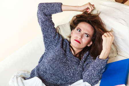 taking nap: Health balance sleep deprivation concept. Woman lying on couch suffering from head pain taking power nap