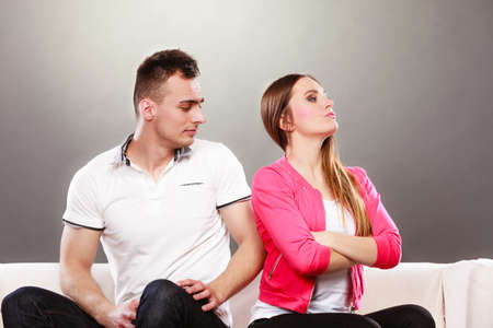 not talking: Young couple not talking to each other after argument quarrel. Disagreement in relationship. Man and woman get mad.