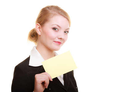 recommending: Advertisement. Young woman holding blank copy space yellow business card isolated on white. Businesswoman recommending your product