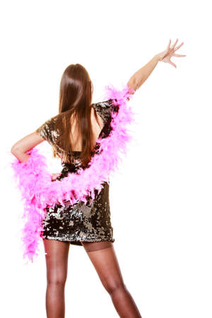 feather boa: Party new year celebration and carnival concept. Elegant woman in evening sequin dress pink feather boa dancing isolated on white background.