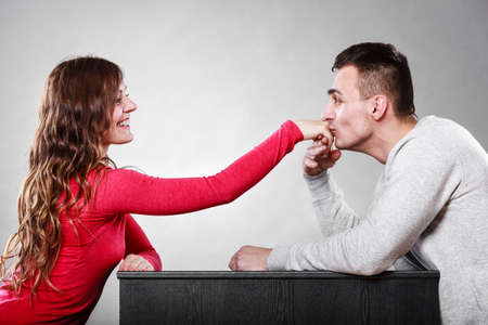wife: Polite man, husband kissing woman hand palm. Good, happy relationship. Love couple concept.