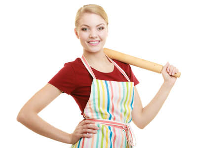 woman cooking: Happy housewife or baker chef wearing kitchen apron holds baking rolling pin studio picture isolated on white