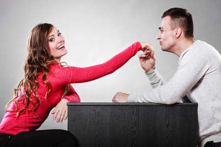 Polite man, husband kissing smiling woman hand palm. Good, happy relationship. Love couple concept.