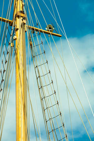 yachting: Yachting. Sailboat view of different parts of yacht. Mast against blue summer sky