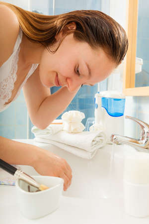 removing make up: Woman cleaning washing hands under running water in bathroom sink basin. Hygiene.