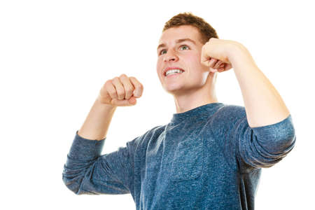 lad: Success positive emotions. Happy young man successful lad with arms up looking upwards isolated on white background Stock Photo