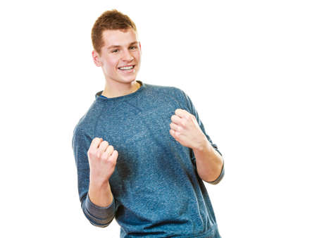 cool people: Success positive emotions. Happy young man successful lad with arms up clenching fist isolated on white background