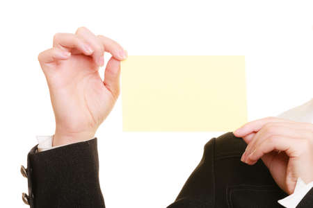 recommending: Advertisement. Blank copy space yellow business card in hands of woman. Businesswoman recommending your product