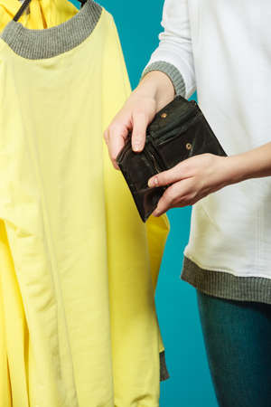 weak: Broke human hands holding empty wallet purse. Lack of money for fashion clothes. Crisis and weak economy concept.