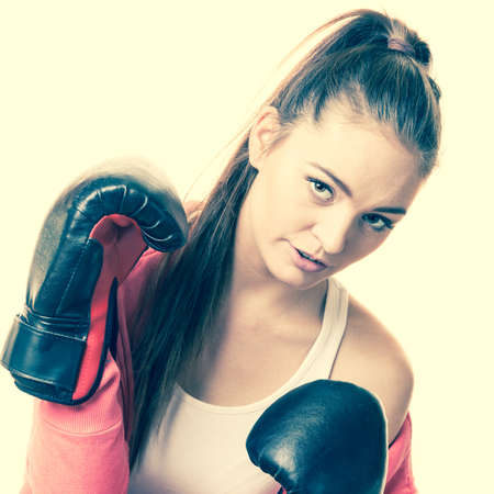 feminist: Emancipation and feminist. Defense concept. Young fit woman boxing. Stock Photo