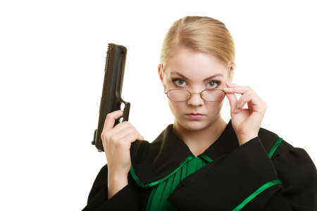 Law court or justice concept. Woman barrister lawyer wearing classic polish black green gown with weapon gun isolated on white. Crime Stock Photo
