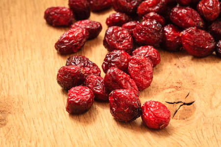 cranberry fruit: Healthy high fiber food organic nutrition. Close up dried cranberries cranberry fruit on wooden table