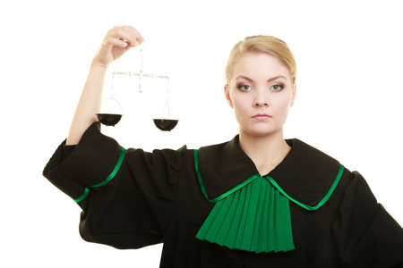 advocate: Law court concept. Woman lawyer attorney wearing classic polish black green gown holds scales. Femida - symbol sign of justice. isolated on white