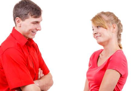flirty: Woman and man contacts with each other. Man talks flirty. Isolated on white. Stock Photo