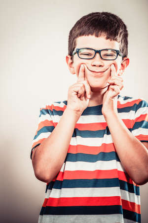 wacky: Crazy kid little boy making silly face expression. Childhood fun. Stock Photo