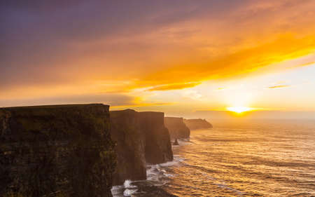 moher: Cliffs of Moher at sunset in Co. Clare Ireland Europe. Beautiful landscape.