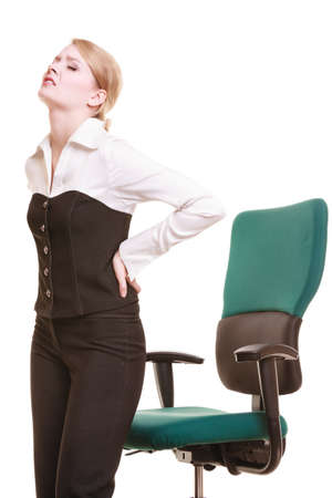working hours: Business. Young businesswoman with backache. Woman with back pain isolated on white. Long working hours and health.