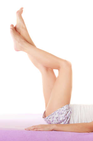 preventing: Health well being and  preventing varicose vein. Woman lying on her back in bed legs raised up high