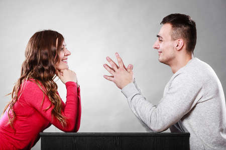 relationship love: Happy couple talking and laughing on date. Smiling girl and guy having conversation. Amusing man making woman laugh. Good relationship. Stock Photo
