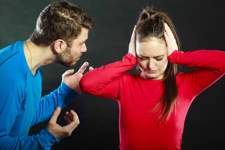 aggresive: Husband abusing wife. Aggresive man screaming at crying scared woman. Domestic violence aggression. Bad relationship.
