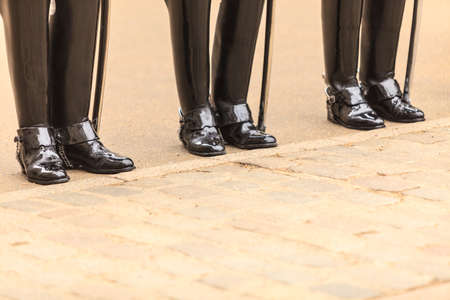 solider: Royal horse guards at the Admiralty House in England. Part of body, solider boots Stock Photo