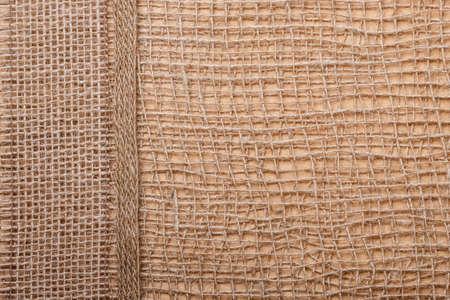 bagging: Jute bagging ribbon on brown mesh material, natural burlap ecology background