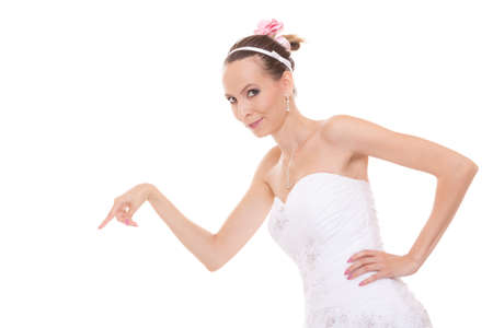 make a choice: Woman bride in white wedding dress choosing picking up make a decision. Choice the perfect candidate for husband. Isolated on white background.