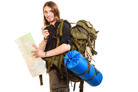 backpack: Man tourist backpacker on trip taking photo picture with camera. Young guy hiker backpacking holding map. Summer vacation travel. Isolated on white background. Stock Photo