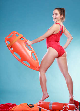 savers: Happy lifeguard with rescue tube buoy. Accident prevention and rescue.