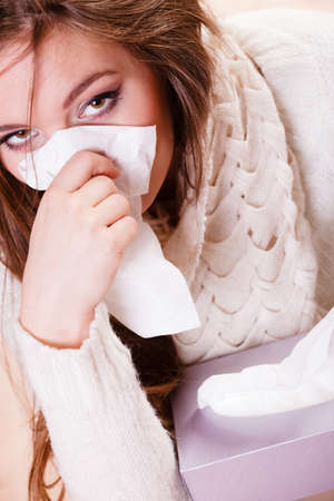 sickly: Flu cold or other virus. Sick woman girl with fever sneezing in tissue, suffering from quinsy. Health care.