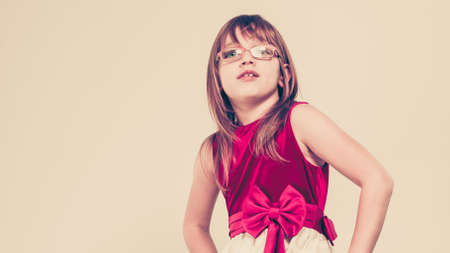 charming girl: Charming little girl in beauty princess dress. Smiling lovely cute female child.