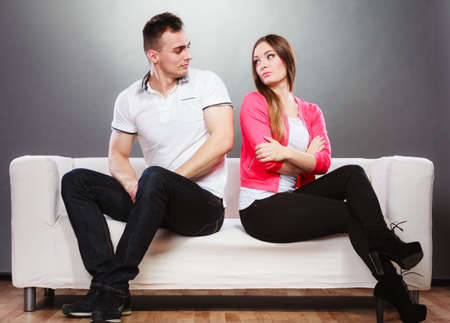 sad couple: Young couple not talking to each other after arguement. Disagreement in relationship. Man and woman get mad. Stock Photo