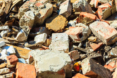 building material: Construction site. Closeup of stack of old grunge destroyed damaged bricks. Industry. Stock Photo
