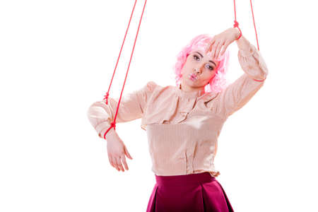 constrained: Young woman girl stylized like marionette puppet on string
