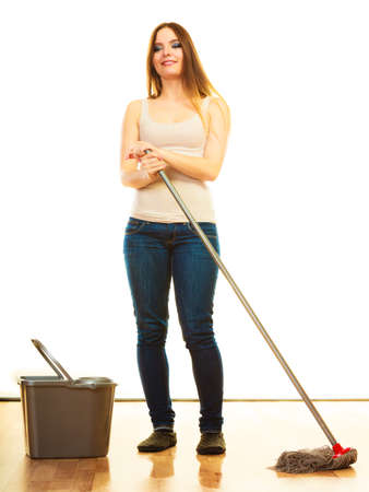 floor standing: Spring cleaning concept. young woman mopping floor, standing with old mop and bucket white background