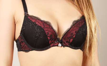 hot breast: Woman in black bra lace lingerie taking care of her breasts, closeup female chest in underwear