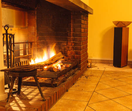 fireplace home: Burning fire wood in fireplace. Home interior indoor. Stock Photo