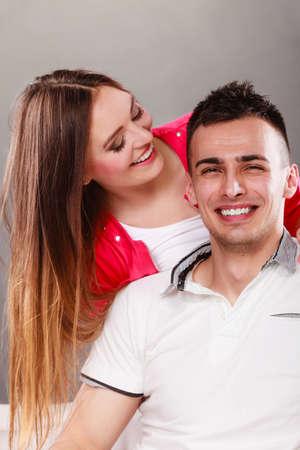 cheek to cheek: Woman kissing man in cheek. Wife and husband flirting. Happy joyful couple. Good relationship.