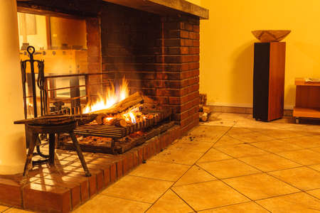 Burning fire wood in fireplace. Home interior indoor. Stock Photo