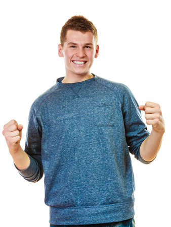 lad: Success positive emotions. Happy young man successful lad with arms up clenching fist isolated on white background