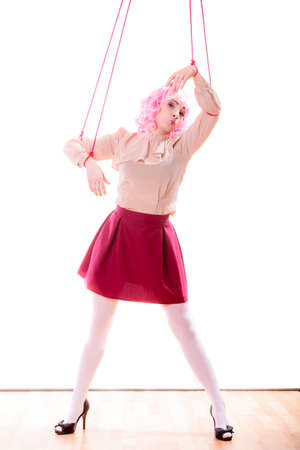 marionette: Young woman girl stylized like marionette puppet on string