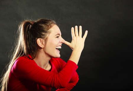 mocking: Happy joyful woman girl mocking having fun playing the fool in studio on black.